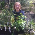 Central Coast Group volunteer Steph with plants for sale